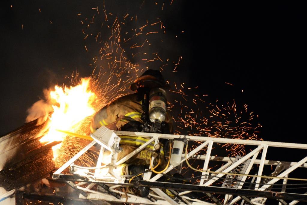 Tim Amidom fighting a fire