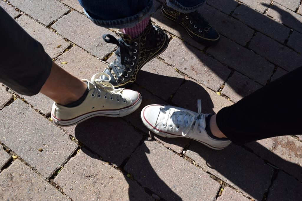 Professors Barb Sebek, Leslee Becker, and Roze Hentschell model the appropriate footwear for touring Eddy Hall