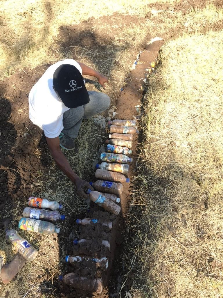 Local Linda Farm resident working on the compost with CSU.