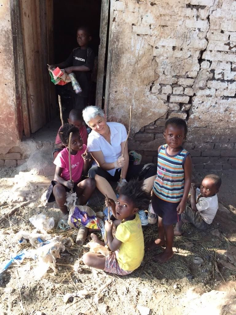Professor Ellen Brinks with Linda Farm Community children making ecobricks for the CSU compost project. Zambia, Summer 2015