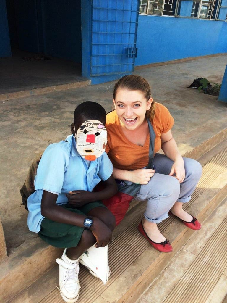 Silas and Morgan Bennett together at Libuyu Community School. Silas is showing off his Art Club mask.