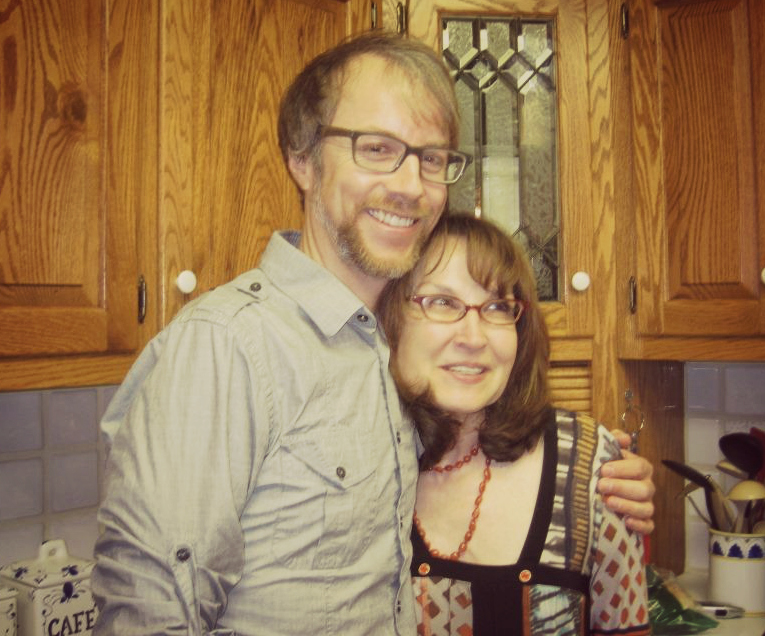 Deanna with Justin Hocking at a potluck she hosted for him, a visiting writer and English alumnus