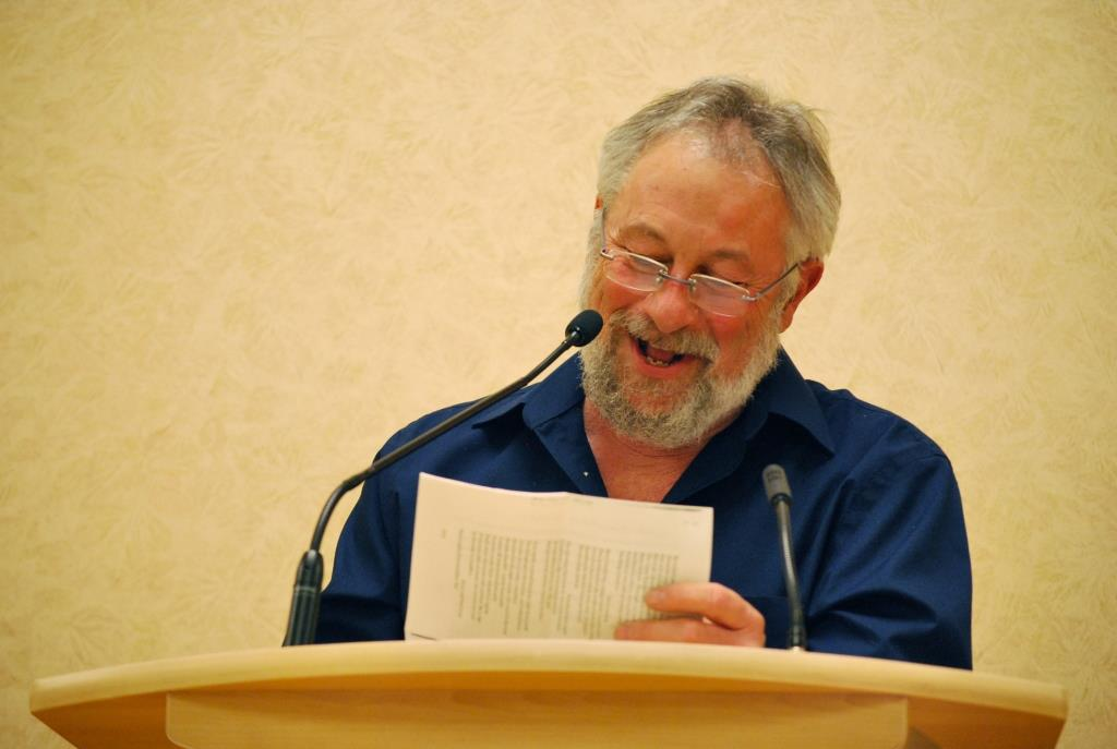 John at lectern