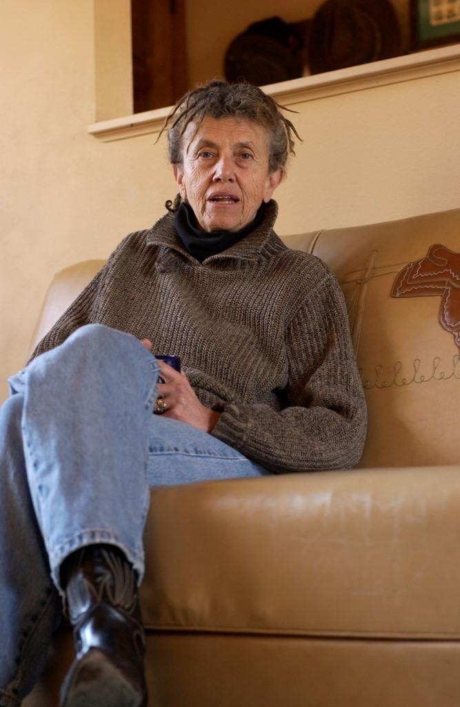 Leslee Becker talks in her living room, January 25, 2003.