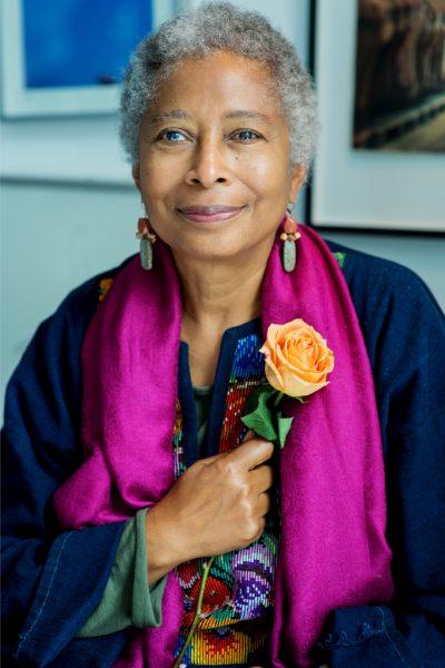 Alice Walker holding a rose