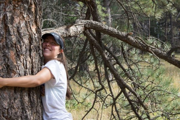 Brooke hugging a tree