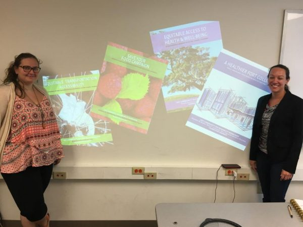Katie Haggstrom and Kristie Yelinek pose with completed student project portfolios