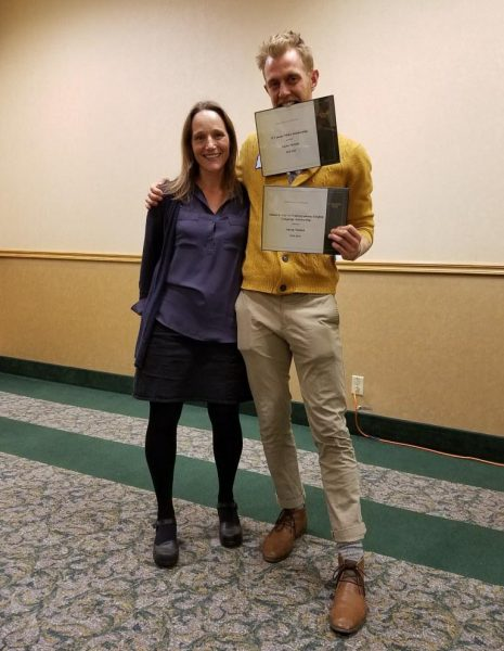 Kristina Quynn and Aaron Nichols with his two awards