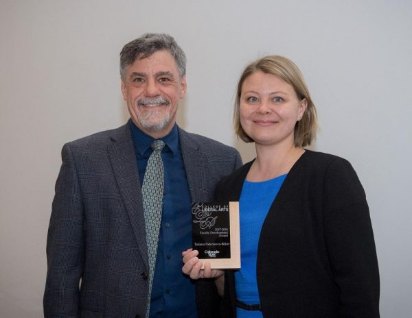CLA Dean Ben Withers presents Tatiana with her award