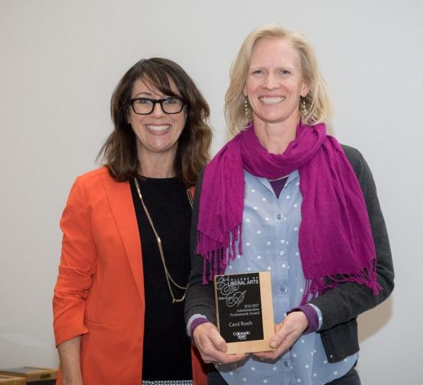 Roze presents Carol her award