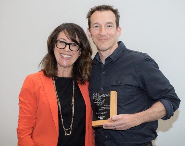 Roze gives Todd his award