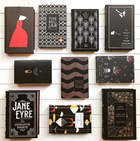 A display of books with a black and red aesthetic including The Handmaid's Tale, The Bell Jar, Jane Eyre, and Jane Austen.