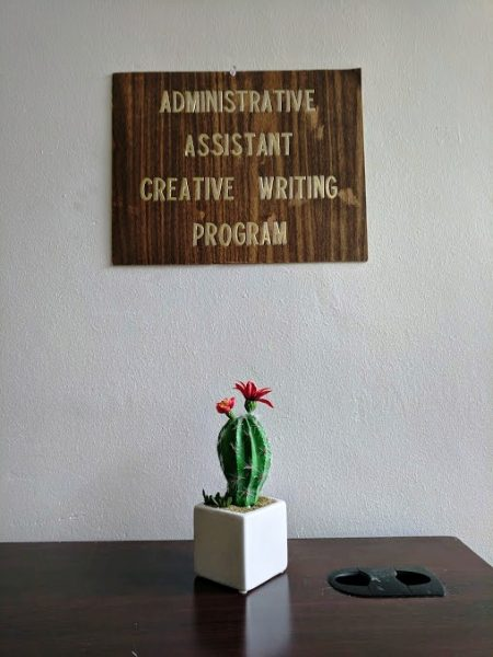 Administrative Assistant Creative Writing Program sign with cactus on table