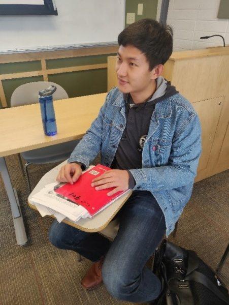 Frank sitting in class