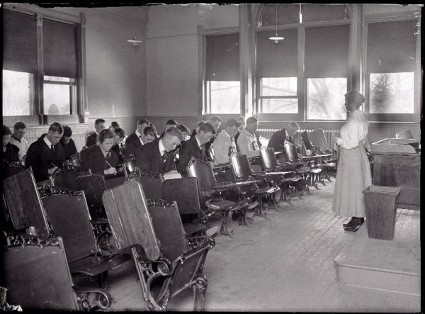 Historical photo of classroom teacher and students
