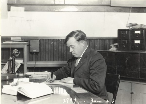 Alfred Westfall at his desk