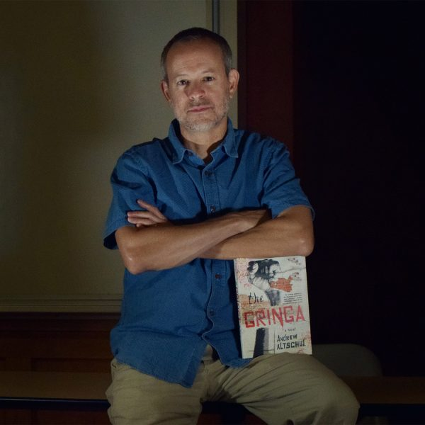 Andrew Altschul with his book The Gringa